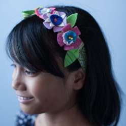 This spring project uses felt in bright color combinations creates a wearable flower headband. This is a great project to go with kids spring apparel, as an Easter project, or spring craft project for kids.