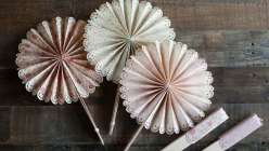 Lia Griffith teaches you how to make scalloped, frilly paper fans that are perfect for a diy wedding or backyard party project. Learn a fold-up version made with a Cricut Explore cutting machine or hand paper crafting.