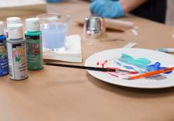 Courtney Cerruti shares an easy technique for cutting out artwork on vinyl using the Cricut Explore, and then painting over the vinyl stencil several times to create an overall design.