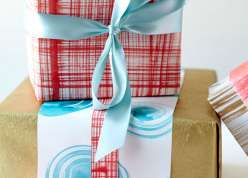 Courtney Cerruti teaches several quick and easy dry-brush techniques to create easy diy painted gift wrap.  Courtney shares unique ideas for mixing and matching papers to wrap any gift.