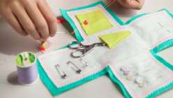Learn how to create a colorful, travel-sized sewing kit with Annabel Wrigley of Little Pincushion Studio. This simple sewing project uses a pattern template for cutting out felt pieces, and the sewing instructions are easy for new sewists to follow.