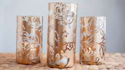Make your own stencils and spray paint vases to make unique tabletop decor.