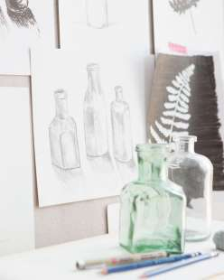 Use bottles and leaves as still life samples to draw and shade
